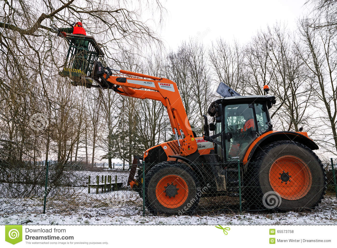 Tractor With Platform : Orange tractor with hydraulic lift and a woodcutter