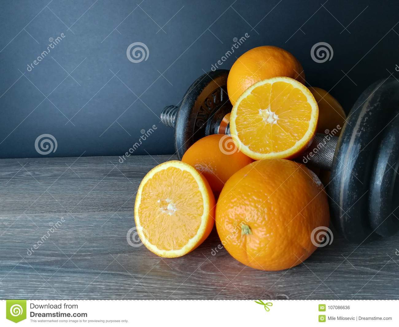 Orange with weights, health and fitness
