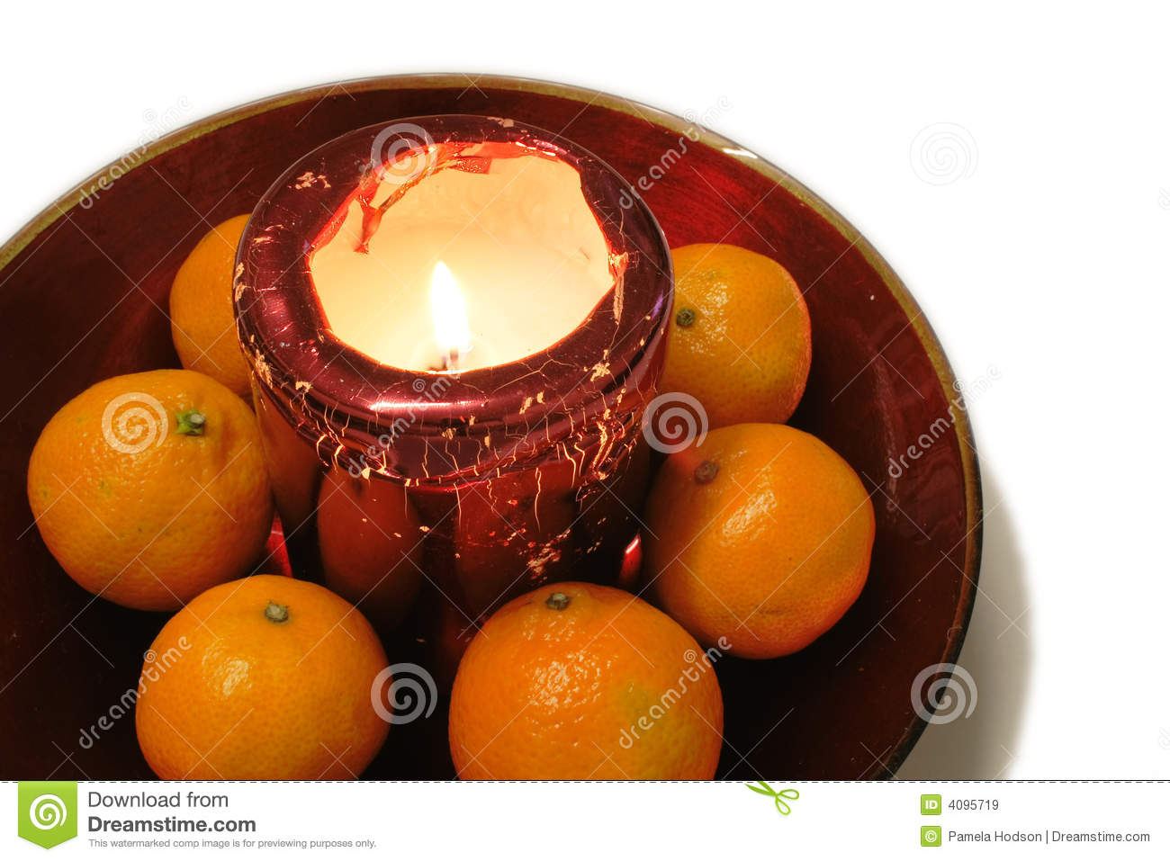 Oranges around a christmas candle decoration royalty free for Baking oranges for christmas decoration