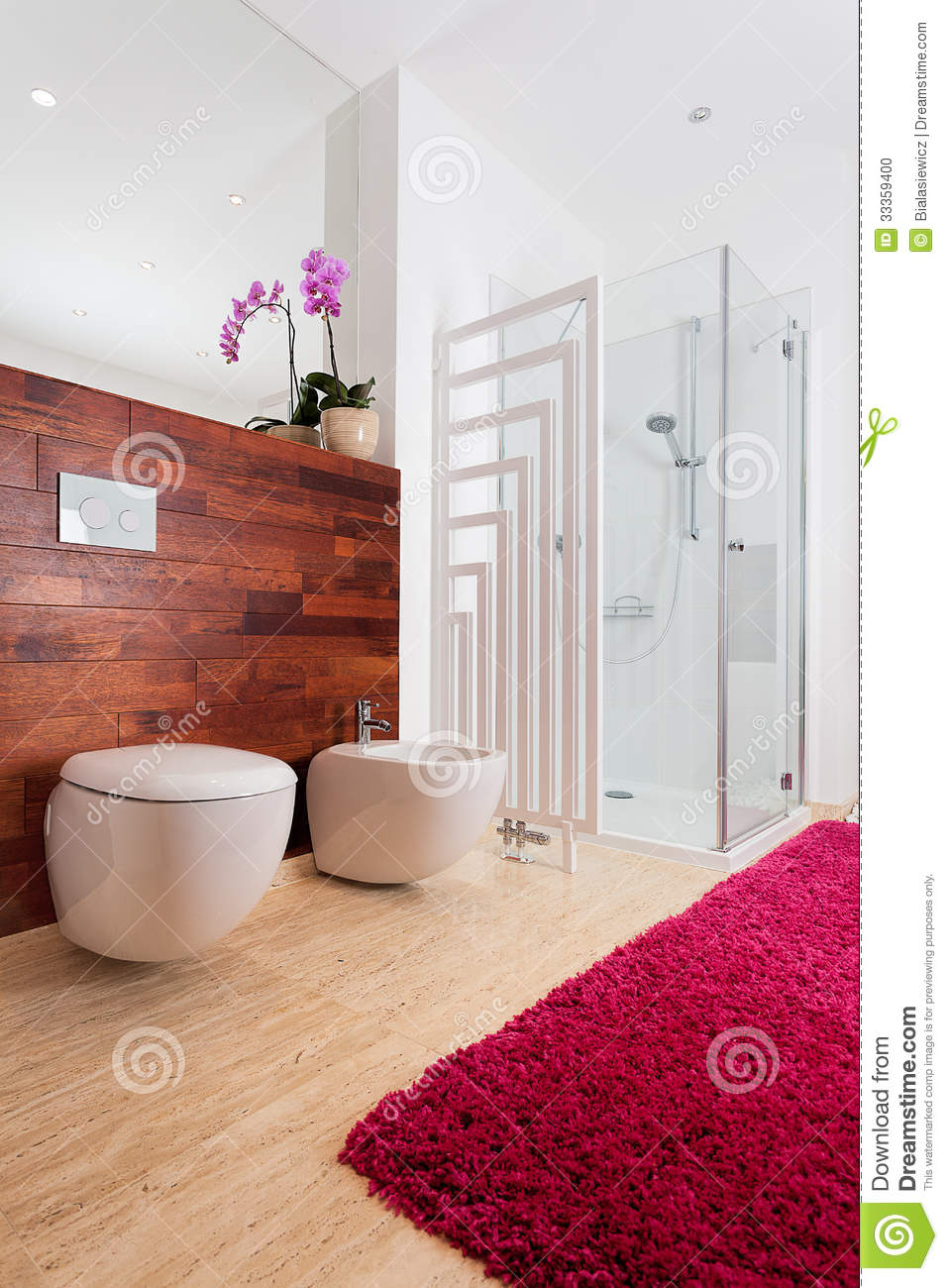 orchid and red carpet in bathroom stock photo image