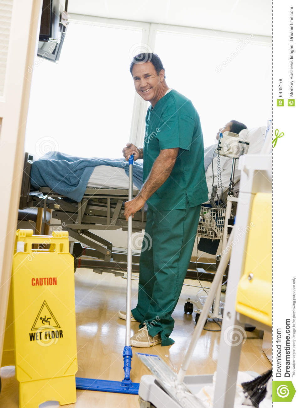 An Orderly Mopping The Floor In A Hospital Stock Image