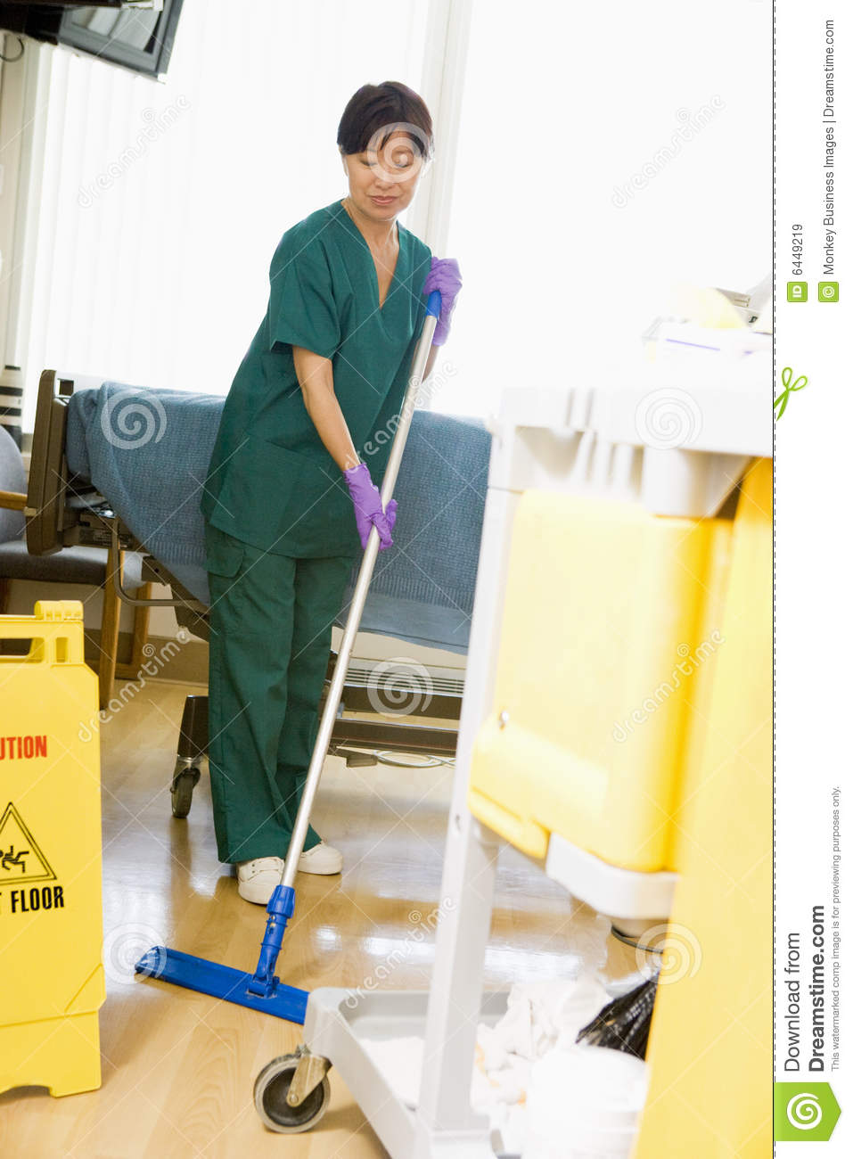 An Orderly Mopping The Floor In A Hospital Royalty Free