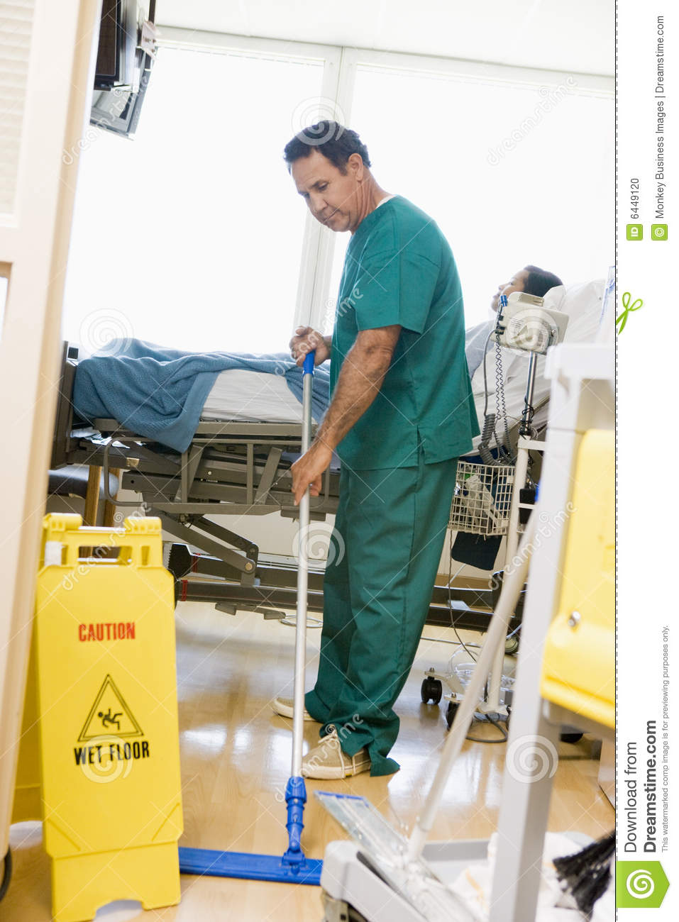 An Orderly Mopping The Floor In A Hospital Ward Stock