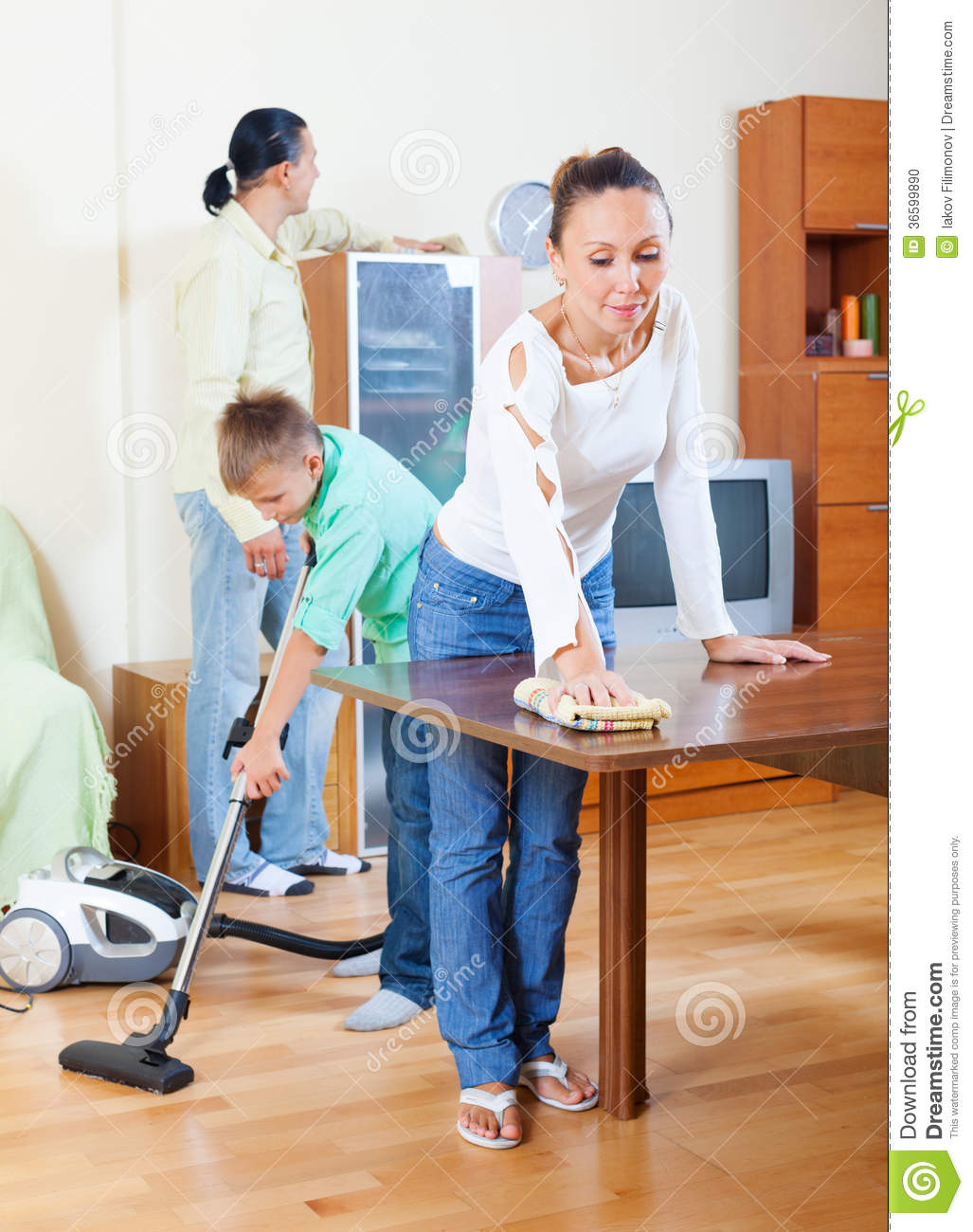 Ordinary family of three doing house cleaning stock photo for House cleaning stock photos