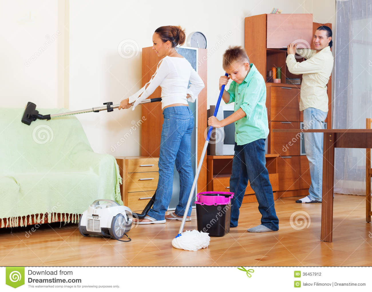 Ordinary family of three with teenager doing housework for Pictures of clean homes