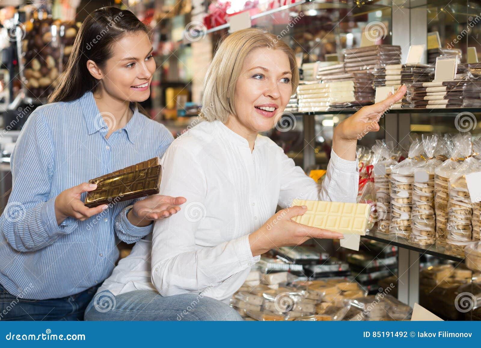 Ordinary female customers selecting chocolate