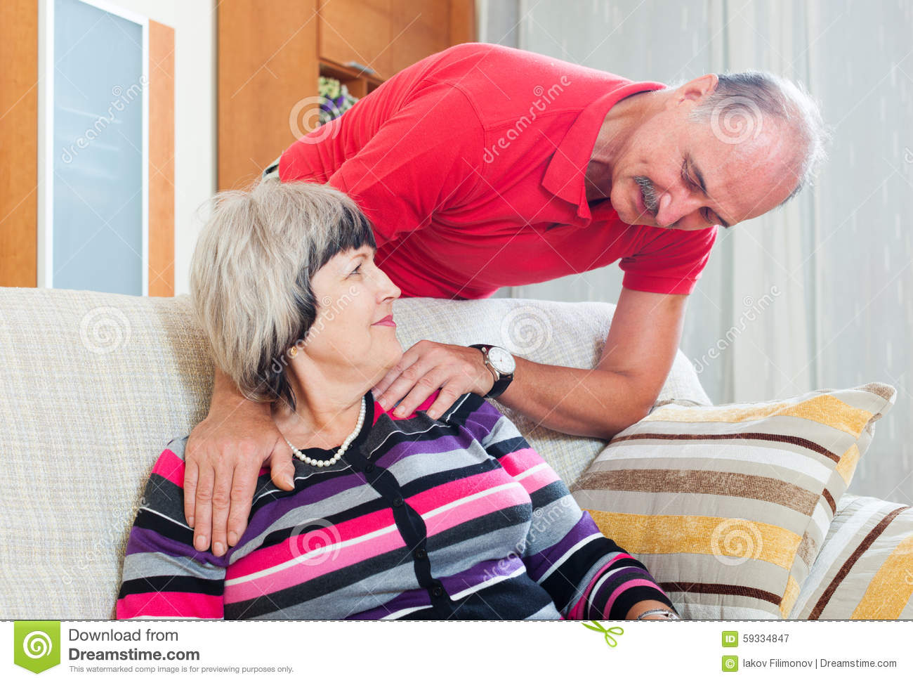 Ordinary mature couple in home