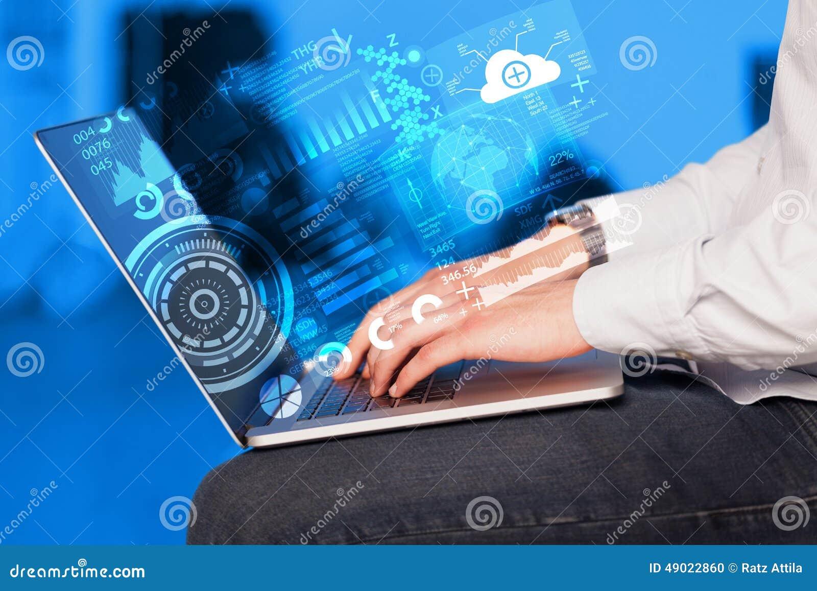 Ordinateur portable moderne avec de futurs symboles de technologie