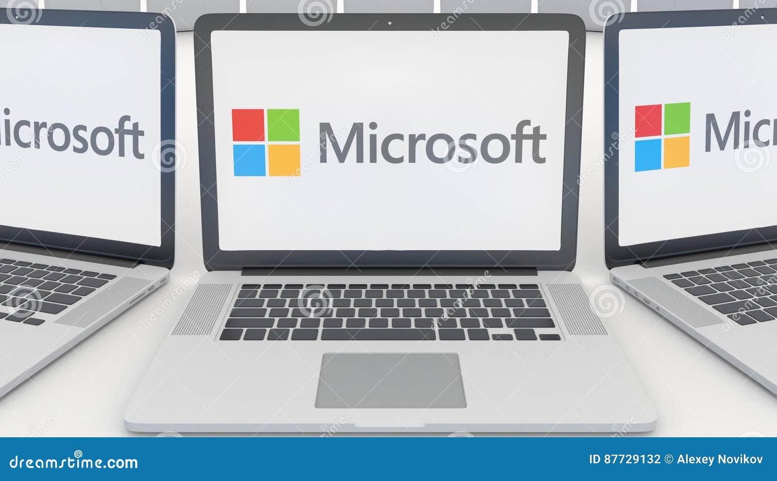 Ordinateurs portables avec le logo de Microsoft sur l écran Rendu conceptuel de l éditorial 3D d informatique