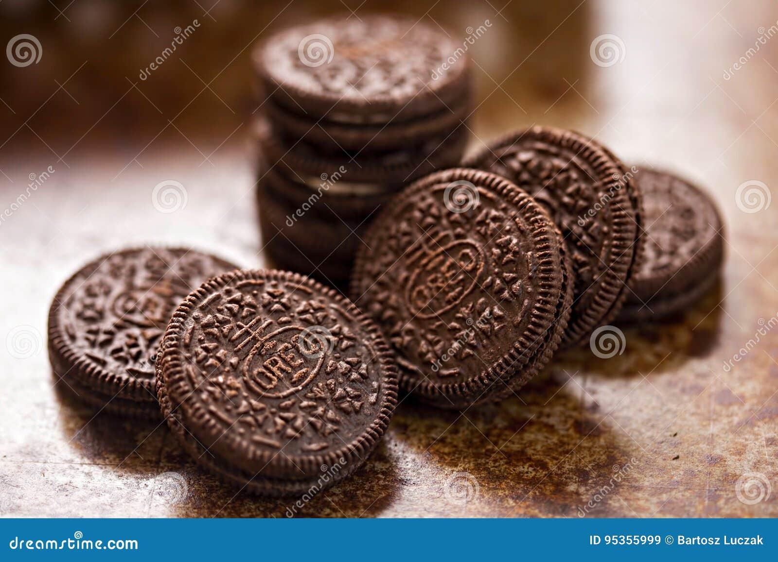 Oreo cookies on dark brown background
