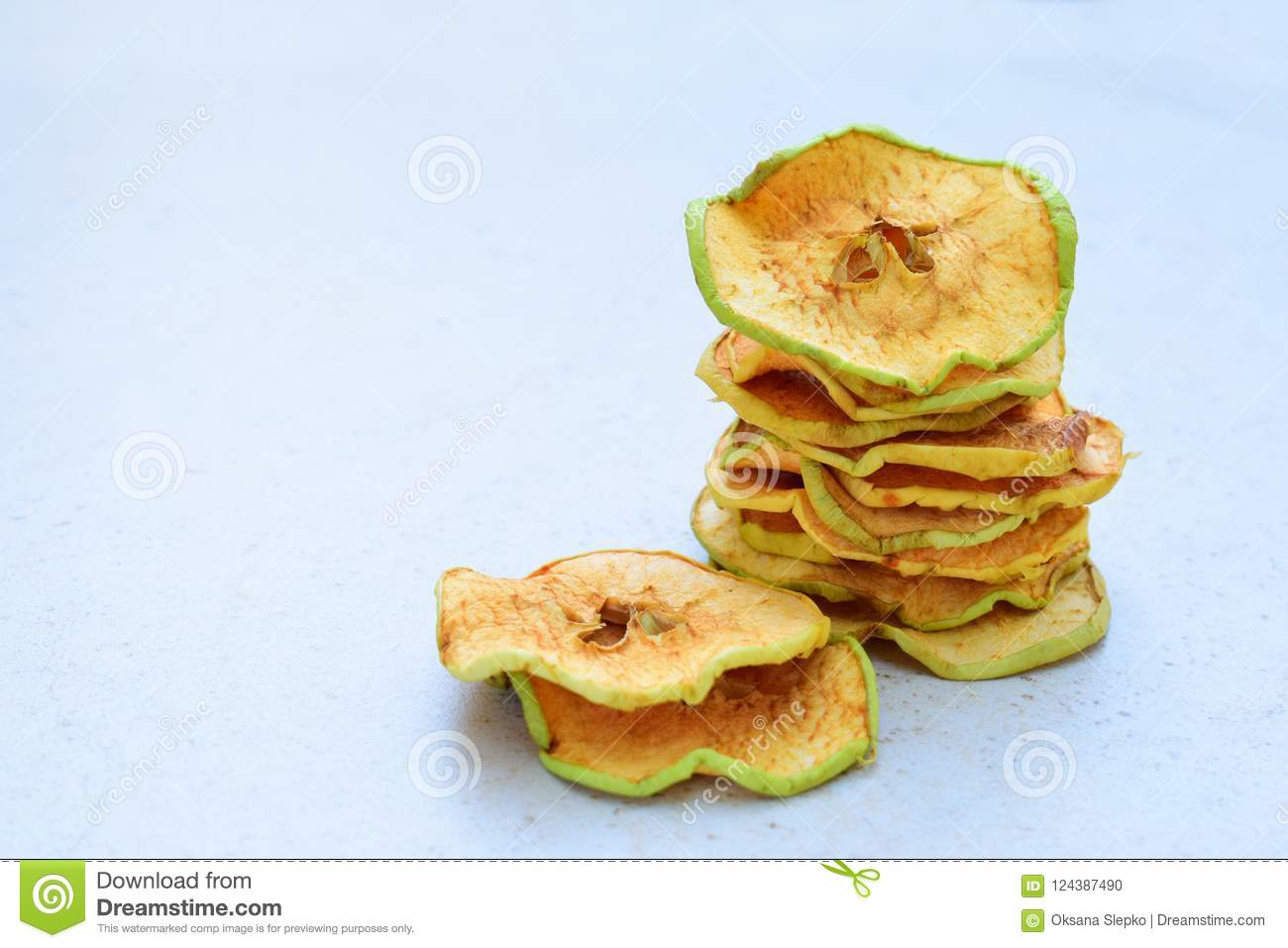 Organic apple chips. Dried fruits. Healthy sweet snack. Dehydrated and raw food. Copy space