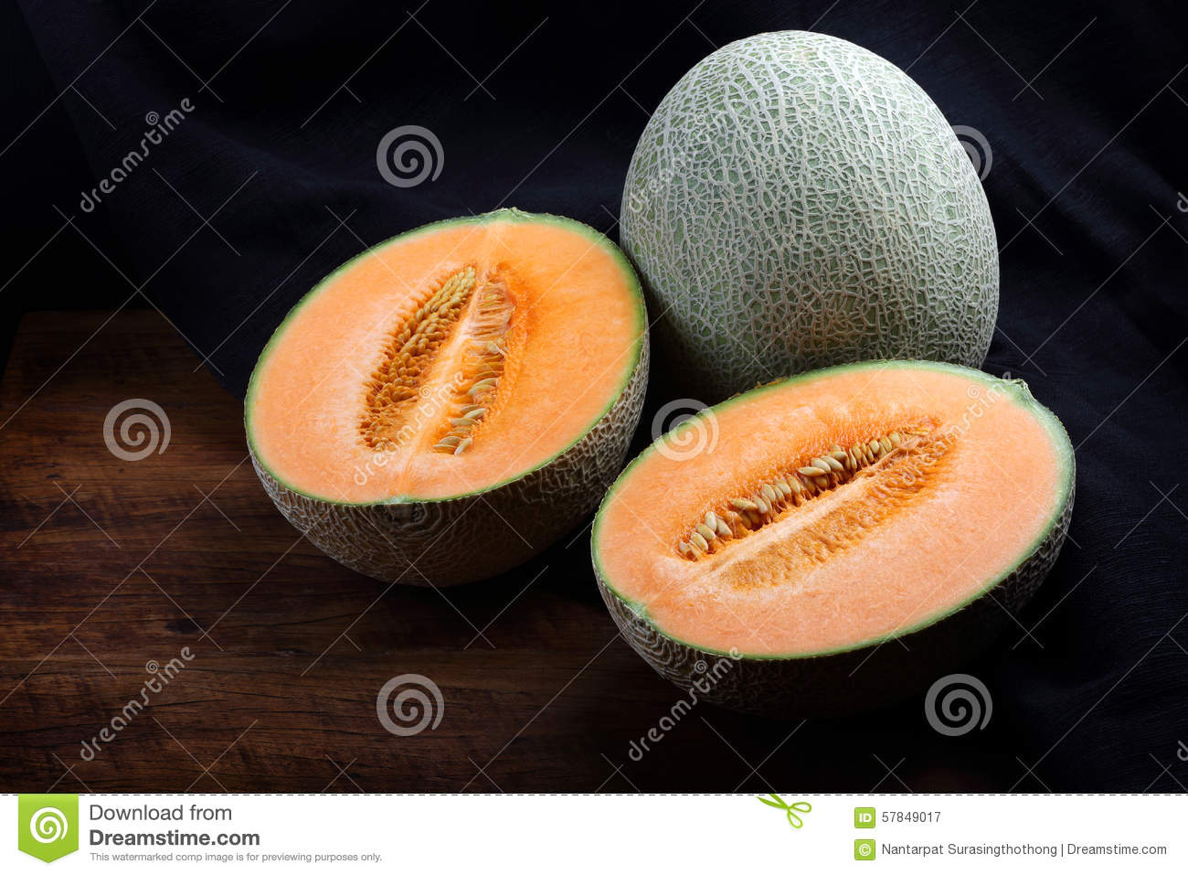 Organic cantaloupe on wooden table