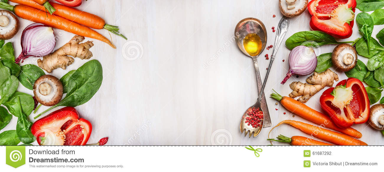 Organic clean vegetables assorted with cooking spoons and oil on white wooden background, top view, banner.