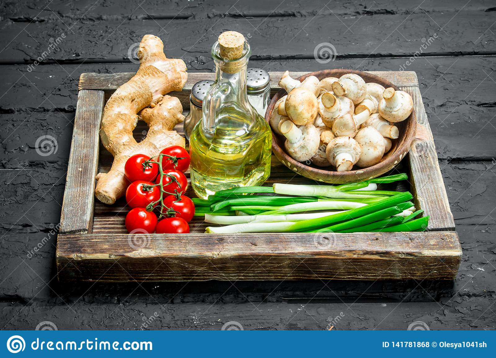 Organic food. Mushrooms with healthy vegetables in a wooden box