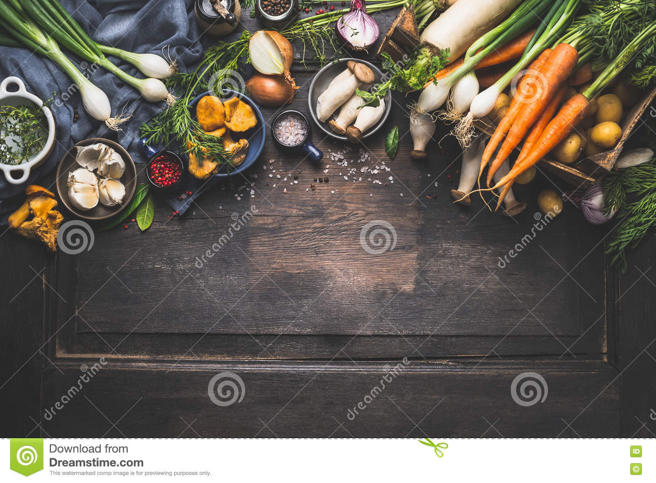 Organic harvest Vegetables from garden and forest mushrooms. Vegetarian ingredients for cooking on dark rustic wooden background