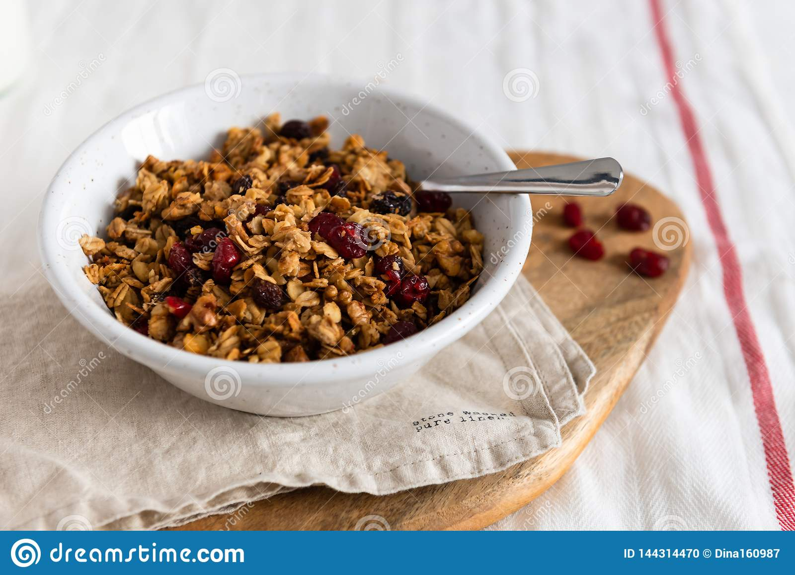 Organic homemade Granola Cereal with oats and walnuts. Oatmeal granola or muesli in bowl. Copy space