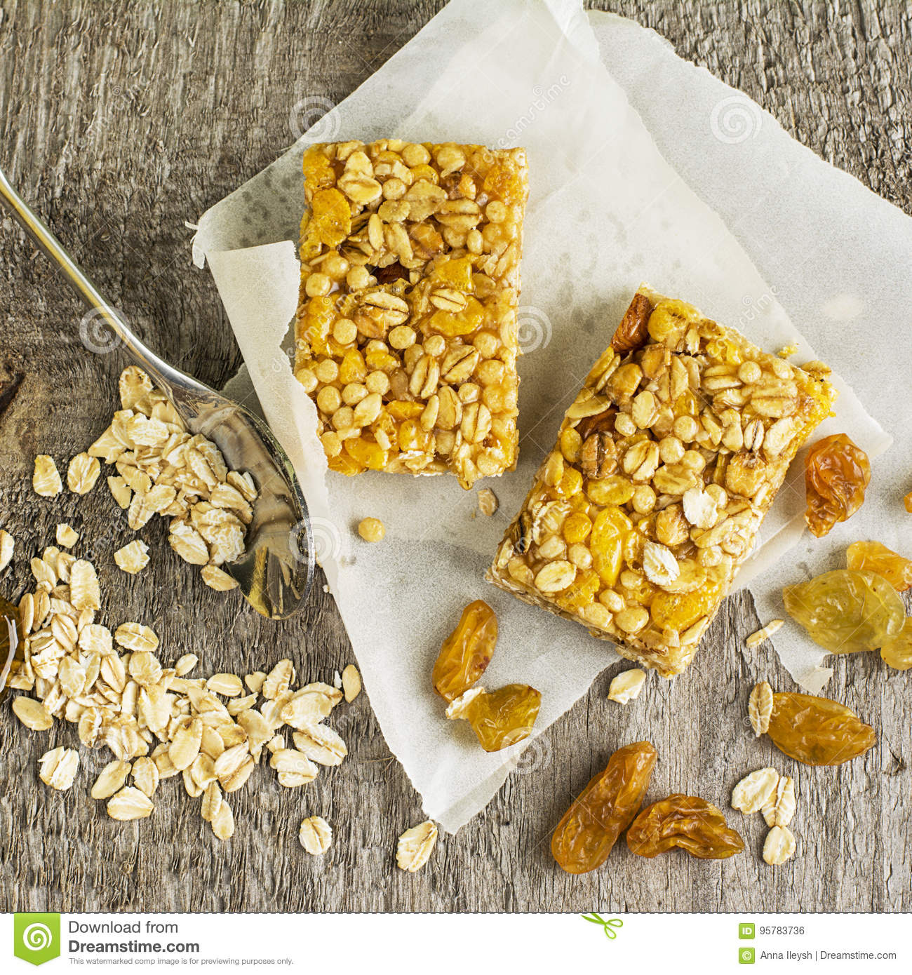 Organic oat cereal bars with honey and golden raisins on a simple download organic oat cereal bars with honey and golden raisins on a simple wooden background ccuart Image collections