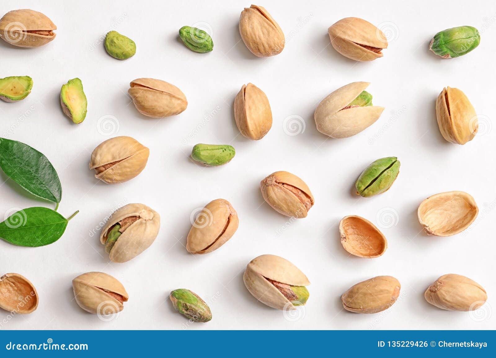 Organic pistachio nuts on white background