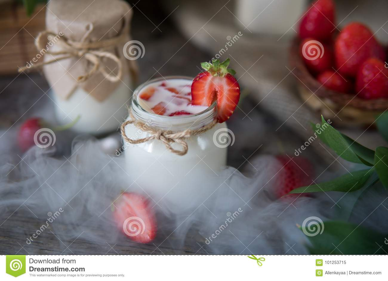 Organic yougurt in jar with strawberry. Fresh strawberry with yo