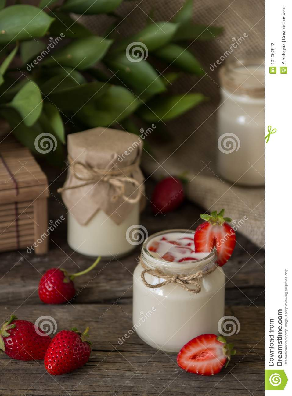 Organic yougurt in jar with strawberry. Fresh strawberry with yo