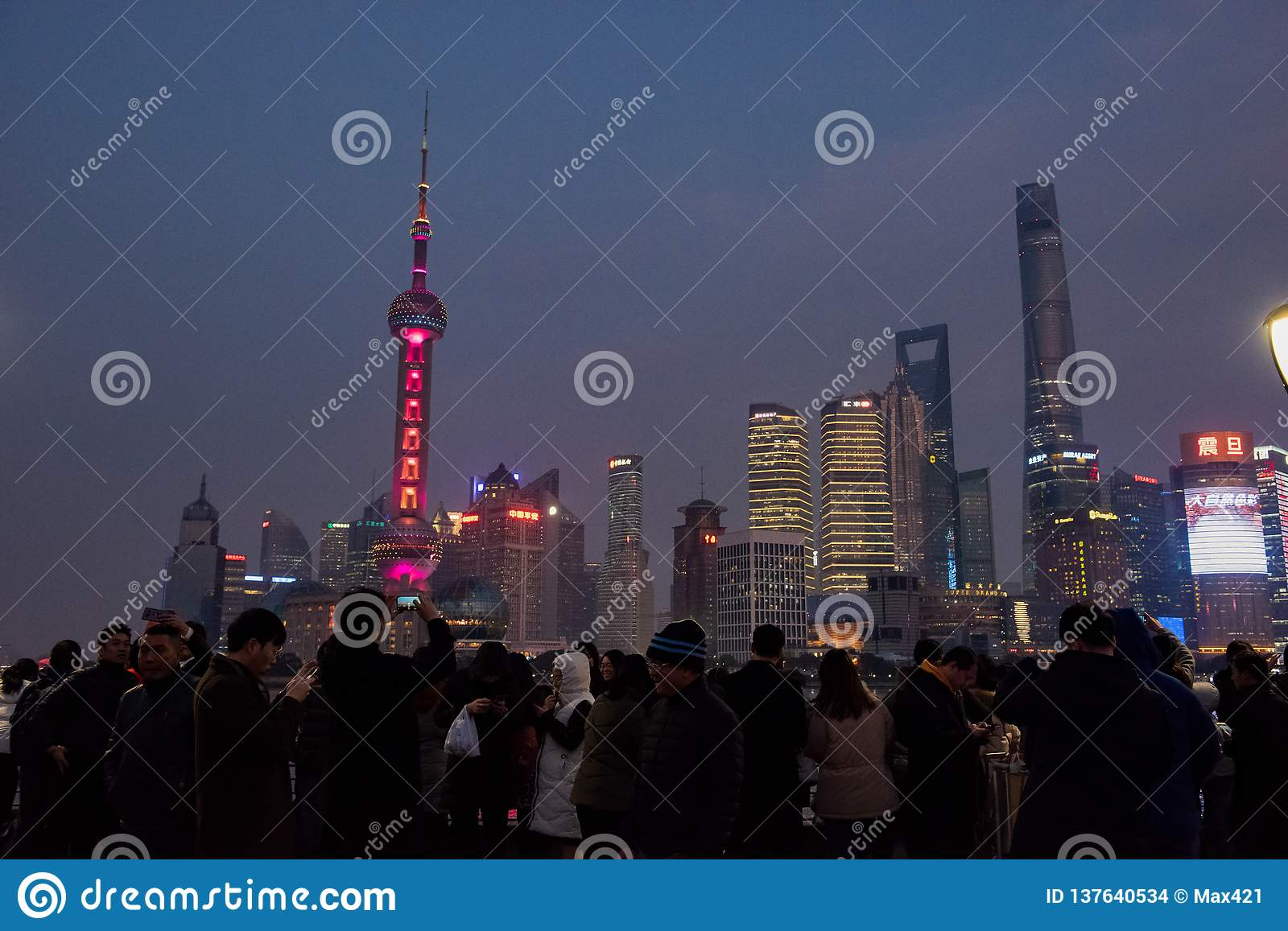Crowds gather at Waitan to view the Oriental Pearl Tower