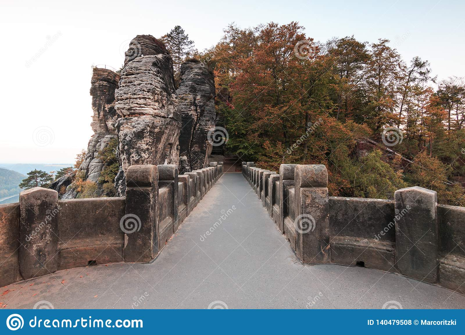 Oriented view on the Bastei bridge with trees and rocks in autumn mood
