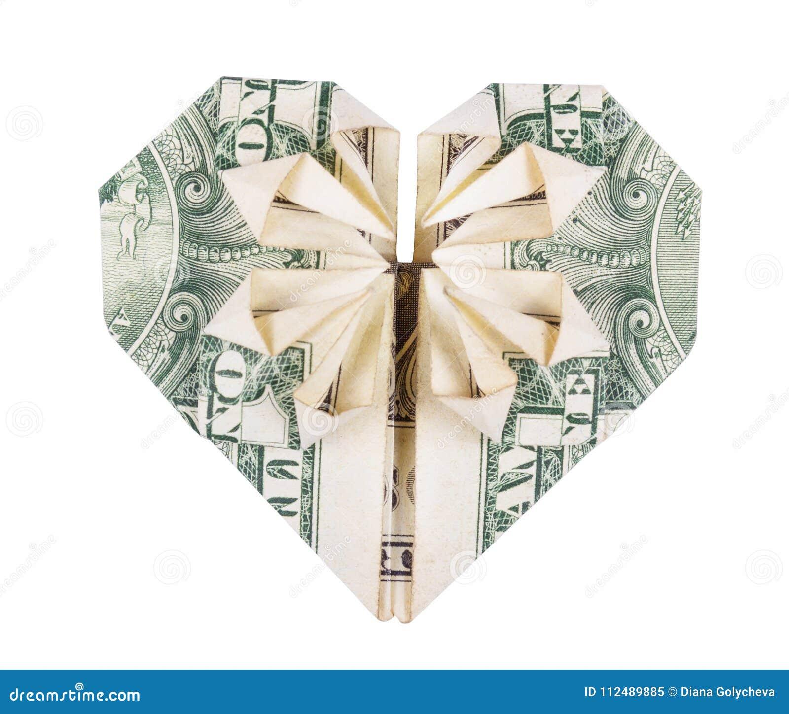 Origami的心脏从美元的 金钱Origami  美元折叠了入在白色背景隔绝的心脏