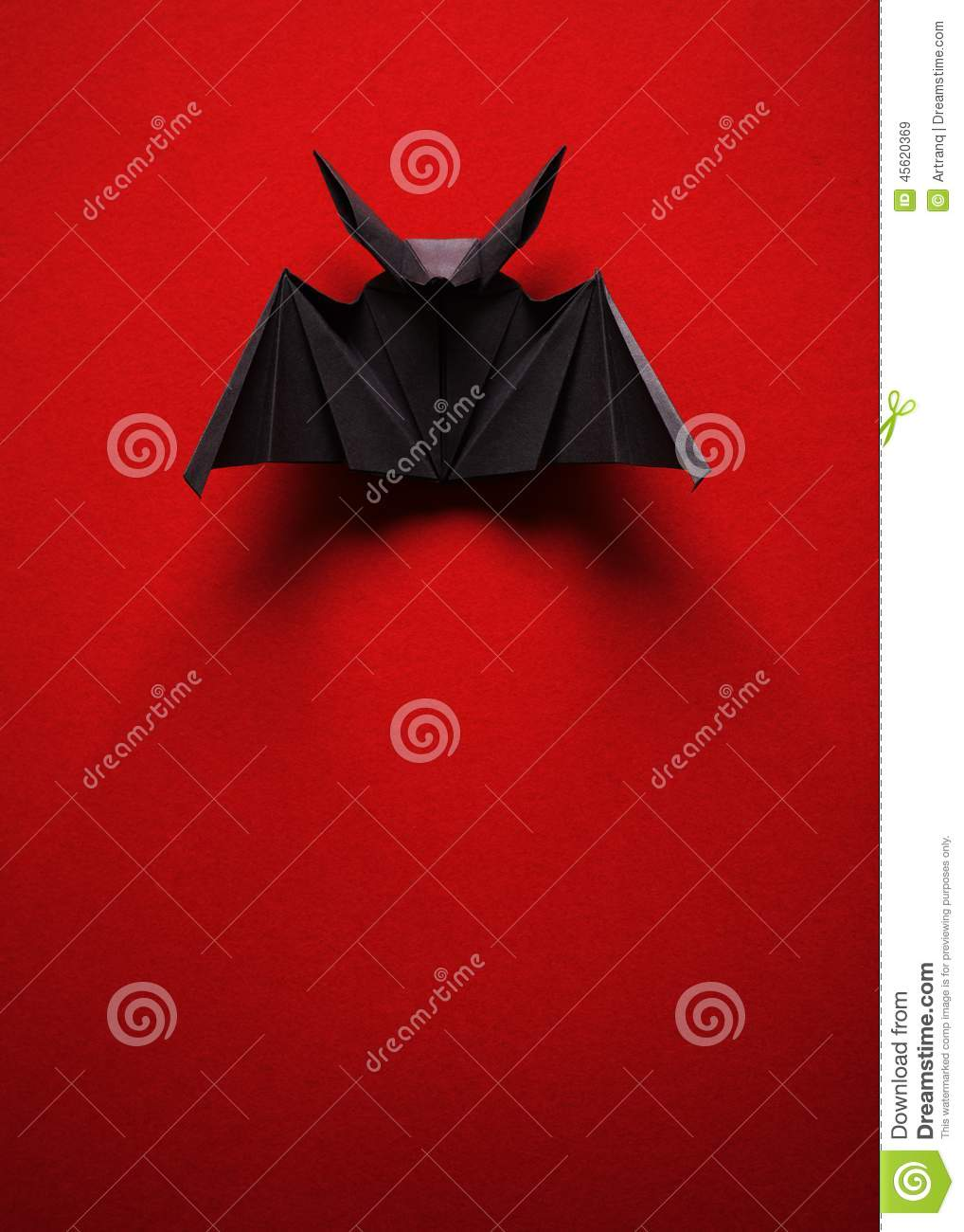 Origami Bat On A Red Background Stock Image