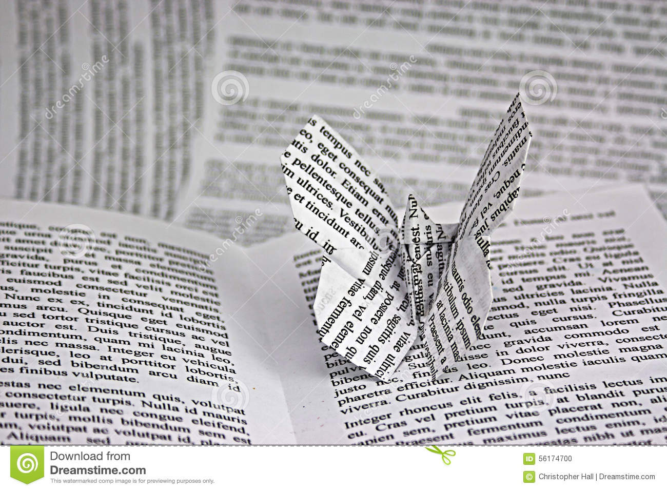 origami butterflies coming out of a book stock photo image of hand
