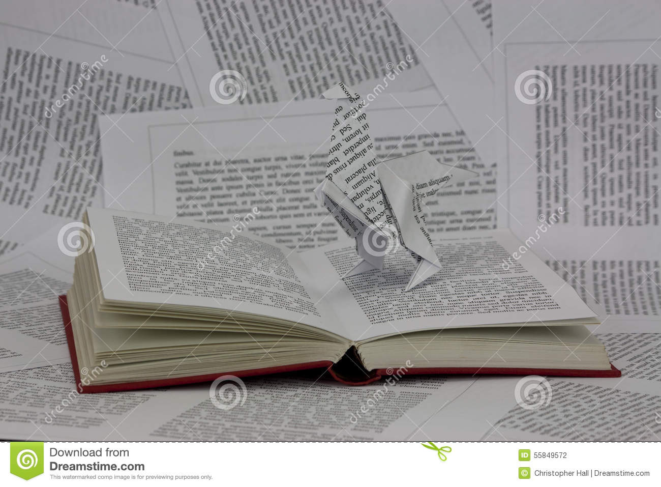 Origami Dinosaur Coming Out Of A Book Stock Photo