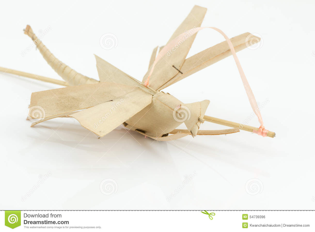 Origami dragonfly from coconut leaf isolated stock photo image royalty free stock photo jeuxipadfo Image collections