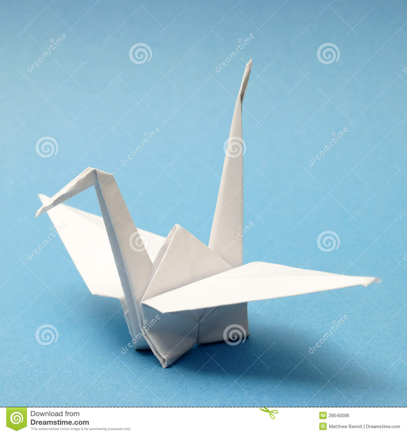 nicely folded origami swan over a blue tranquil background.
