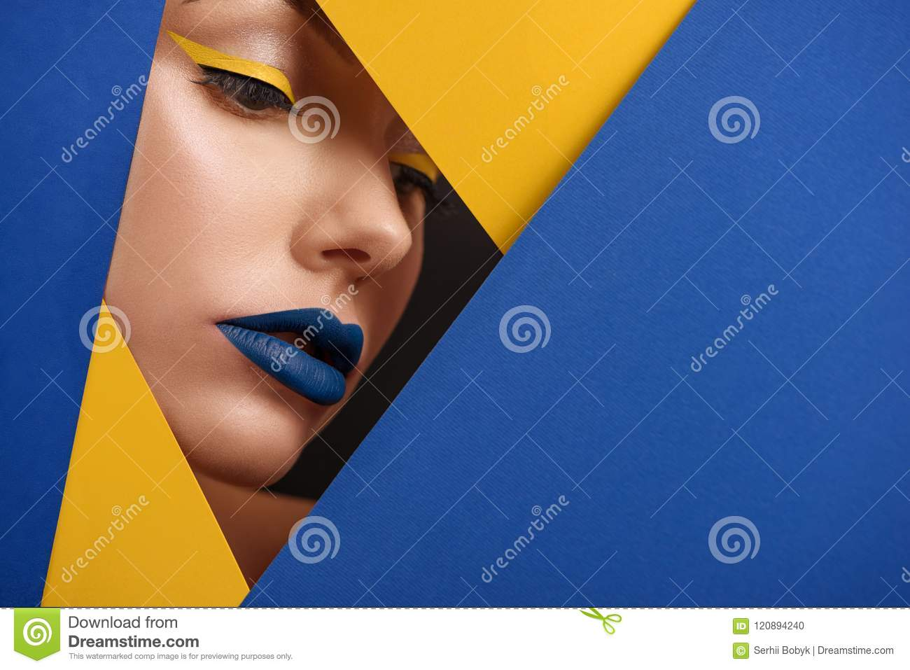 Original beaty close up of girl`s face surronded by blue and yellow carton.