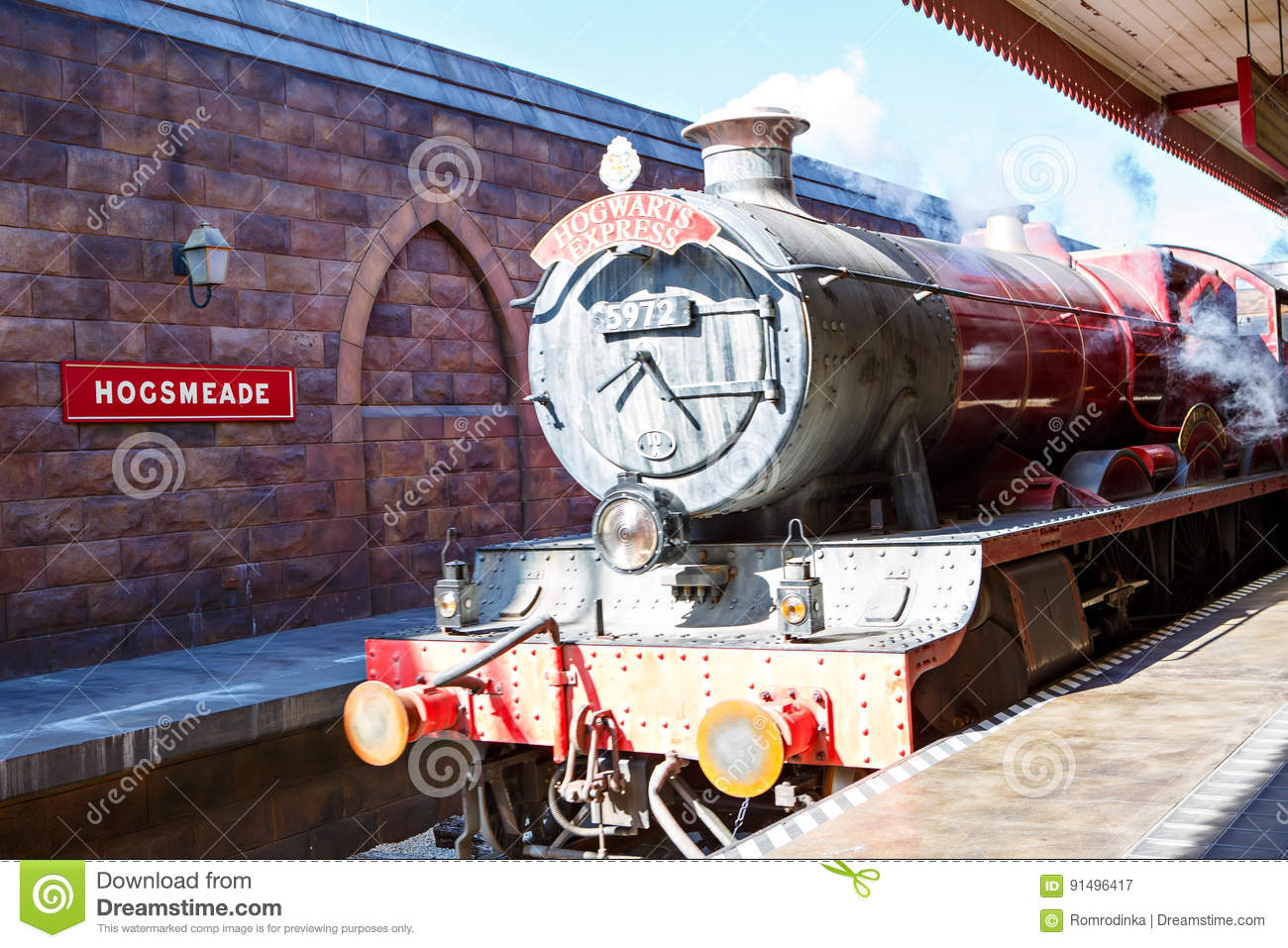 ORLANDO,FL-APRIL 19 2016: Hogsmead and Hogwarts Express train, home to Harry Potter and the Forbidden Journey attraction