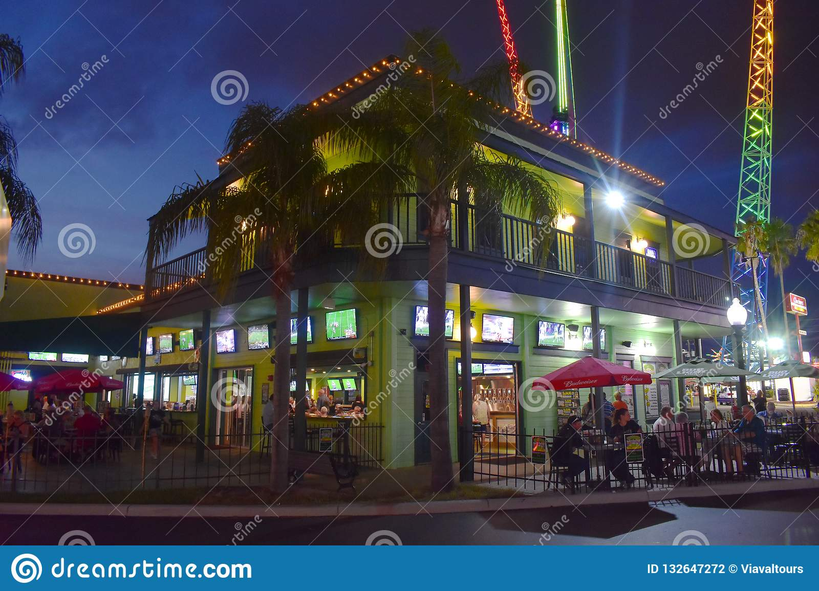 Green Vintage Sport Bar And Colorful Attractions Park At Old