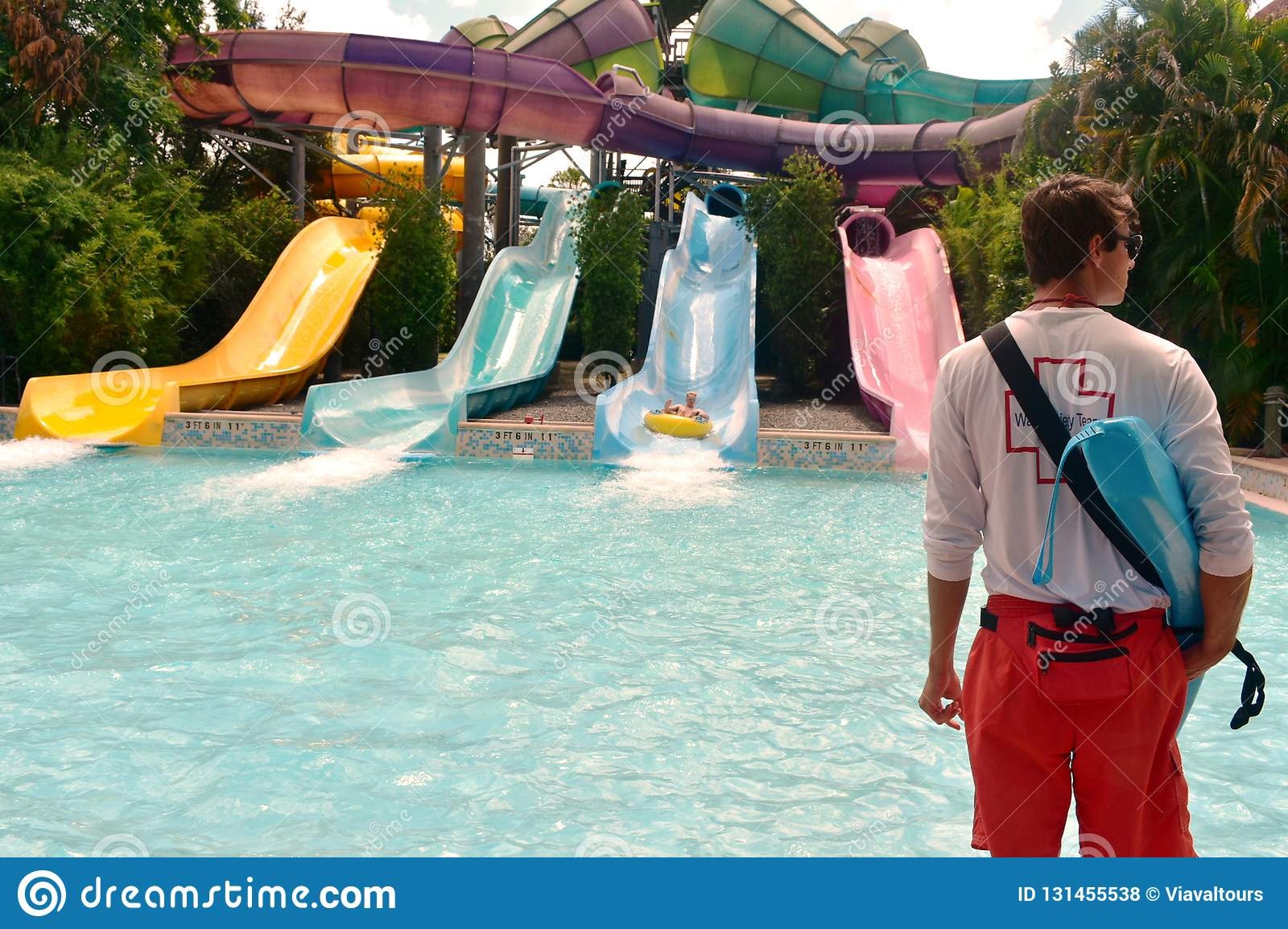 Lifeguard And Person Enjoying In Water Attraction At Aquatica Water