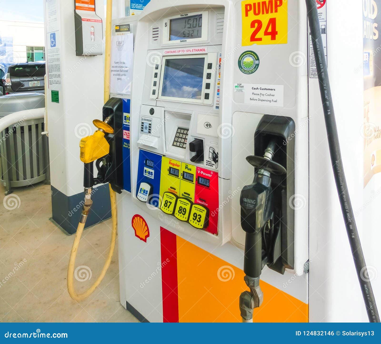 Orlando, USA - May 8, 2018: Filling nozzles at a Shell gas station.