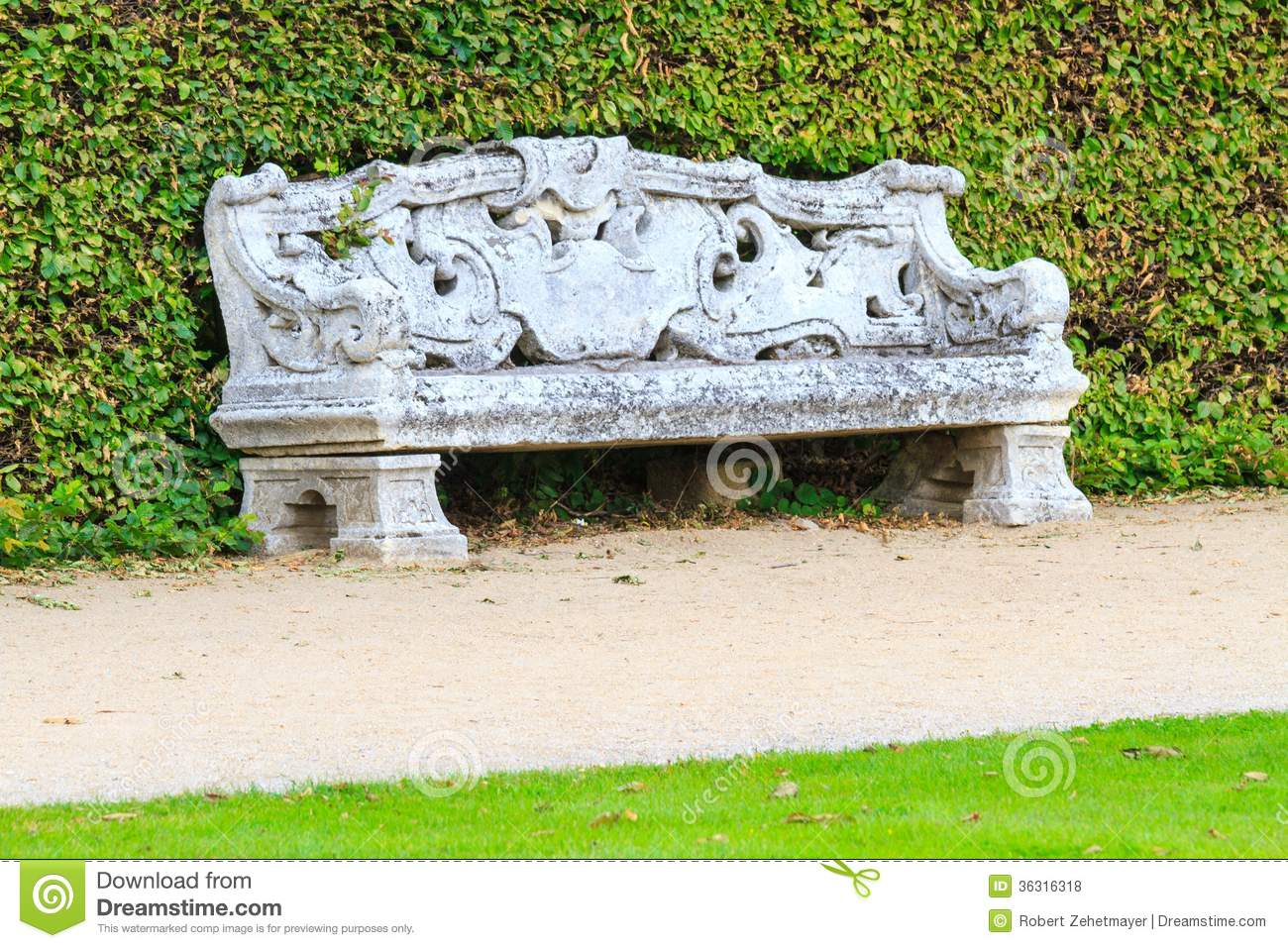 Ornamental English Garden With Stone Bench Royalty Free