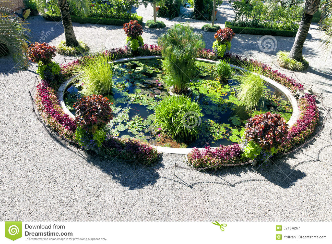 Ornamental garden pond with water plants and flowers stock for Ornamental garden plants