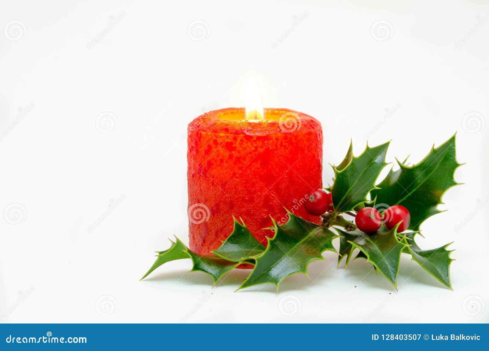 Ornamenti di Natale - candela rossa ed agrifoglio verde