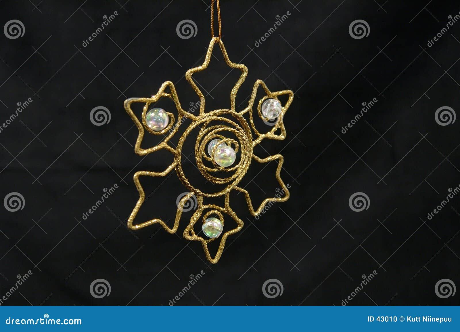 Ornamento do Natal - estrela dourada