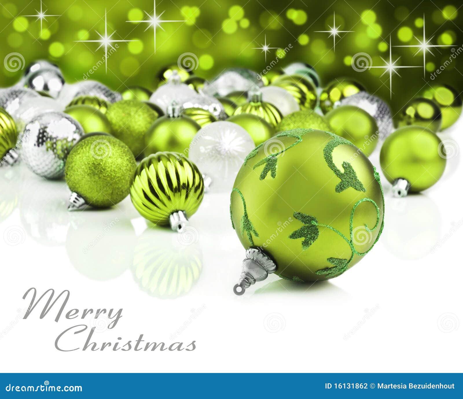 Ornamentos verdes de la Navidad con el fondo de la estrella