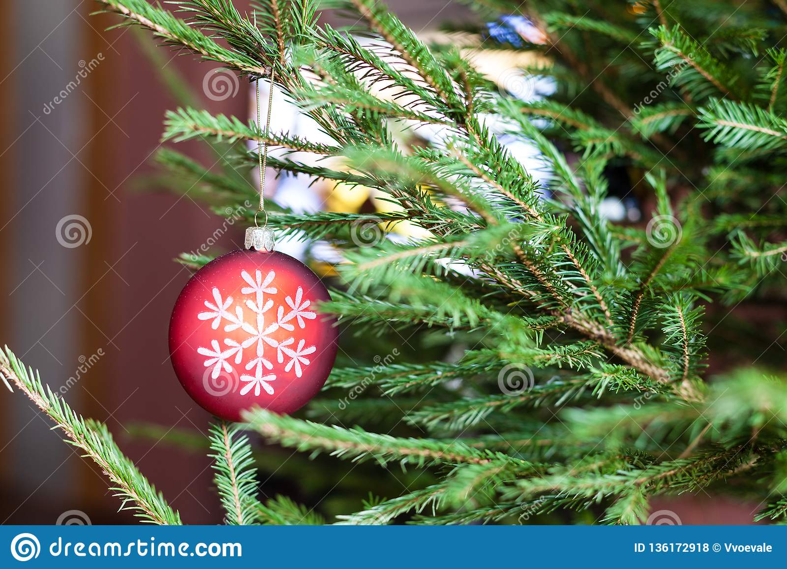Ornaments on twigs of Christmas Tree and TV set