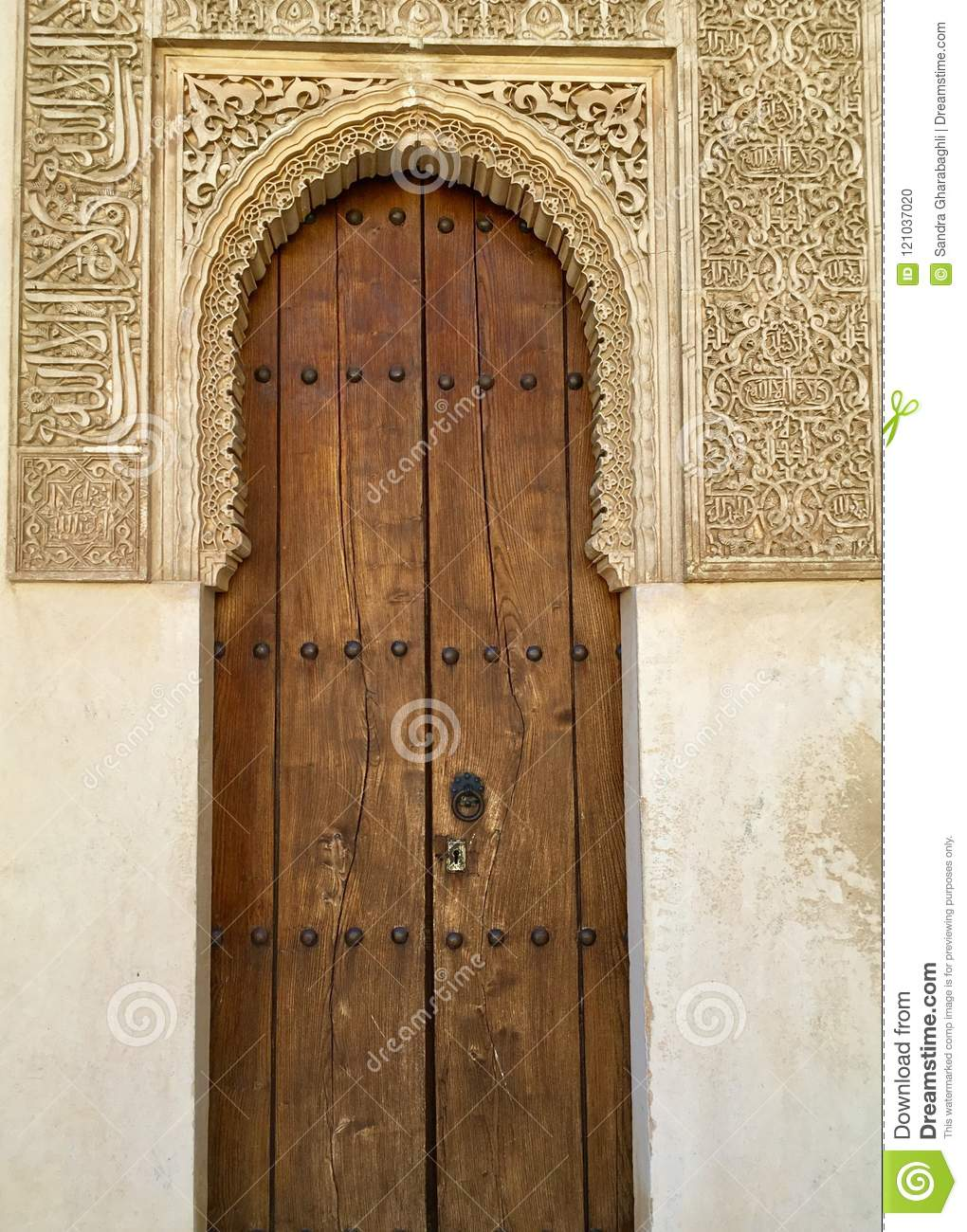Ornate Door Frame And Ancient Wooden Door At Alhambra