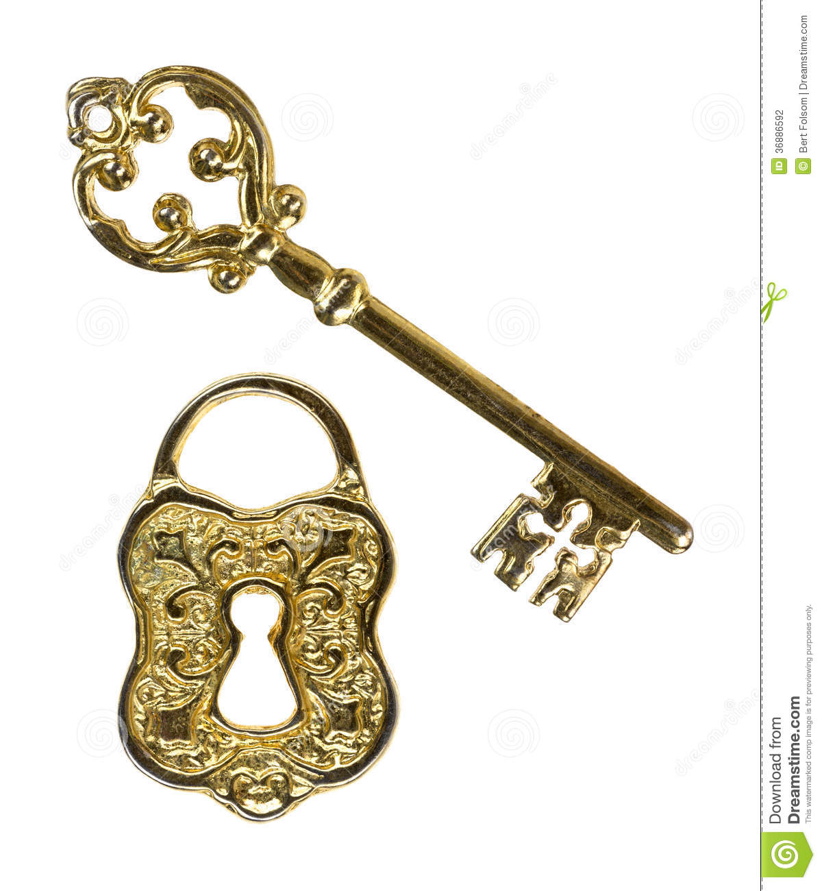An ornate skeleton key and a lock face on a white background.