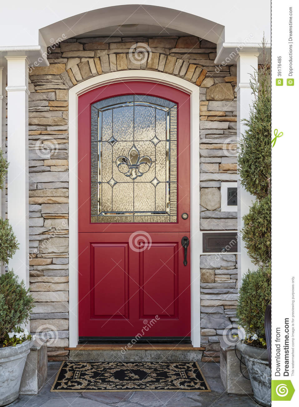 Red Doors Stone : Ornate red front door of a home stock image
