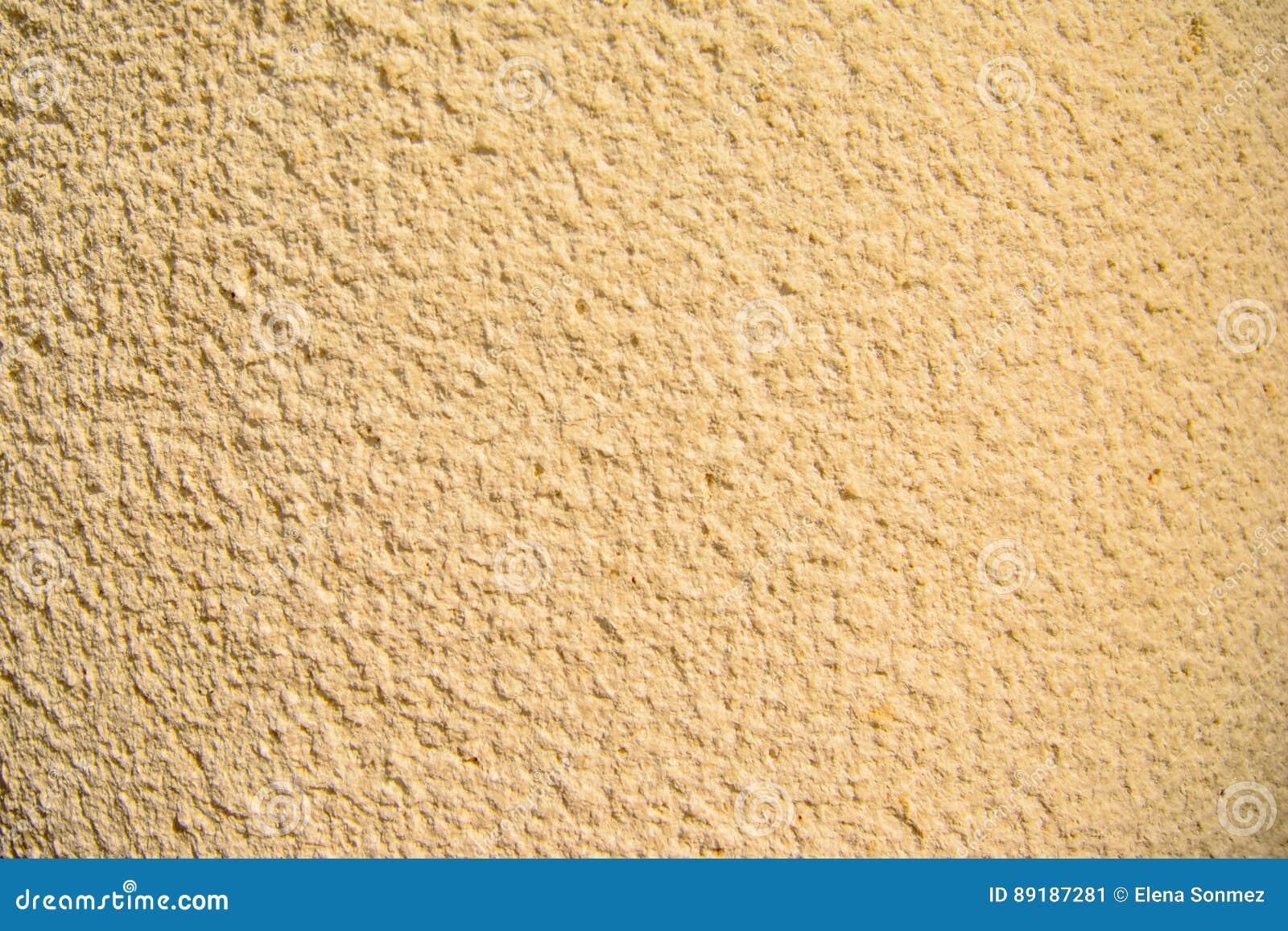 Oro di lerciume e dell annata, crema o fondo beige di cemento naturale o di vecchia struttura di pietra, retro parete del modello