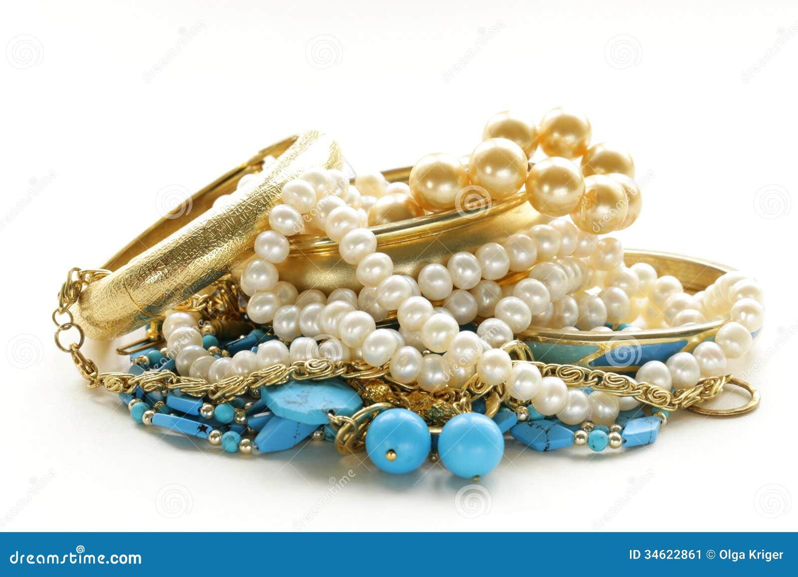 Oro, gioielli del turchese e perla