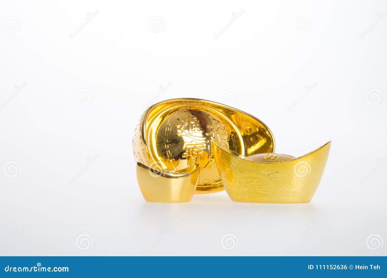 Oro o símbolos chinos del medio del lingote del oro de la riqueza y de la prosperidad