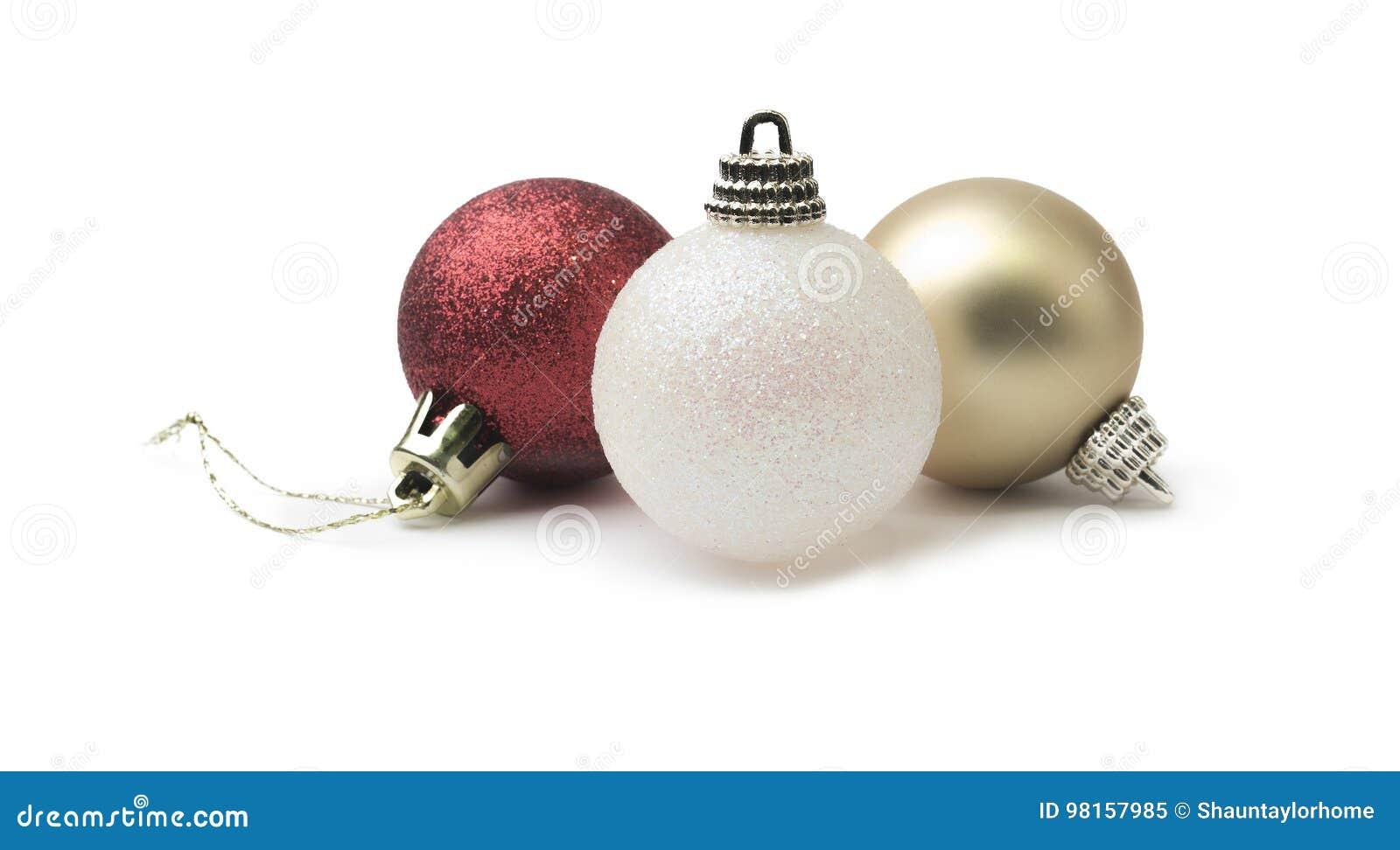 Oro rojo del brillo brillante y chuchería de la Navidad blanca aislada en a